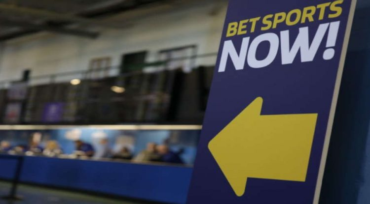 A sign prompting visitors to the betting lounges.