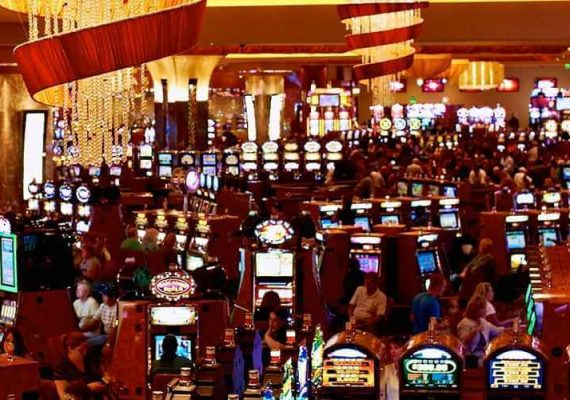 A busy casino floor with people playing all the time