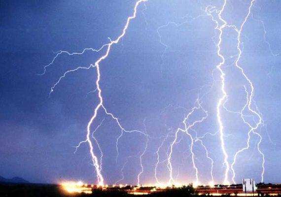 Storm hitting a city at night.