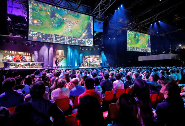 Esports live audience watching a game of Dota 2.