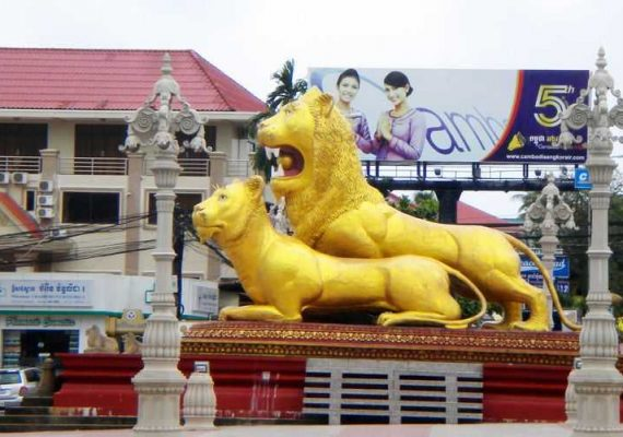 The golden lions at a roundabout in Sihanoukville, Cambodia.