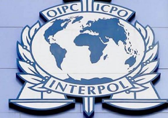 Interpol's logo on a building.