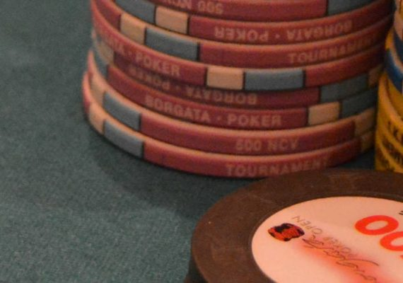 Poker chips at a table.