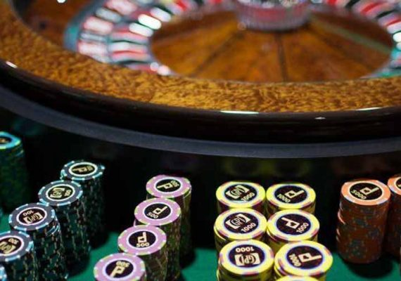 A picture of roulette and gaming chips.