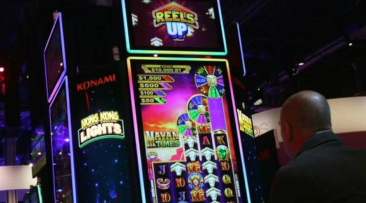 Konami Reels Up feature and KX 43 video slot cabinet.