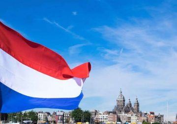 A Dutch flag flapping in the wind.