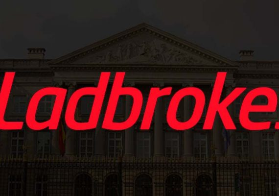 Ladbrokes' logo cast against the Belgian Parliament in the backdrop.