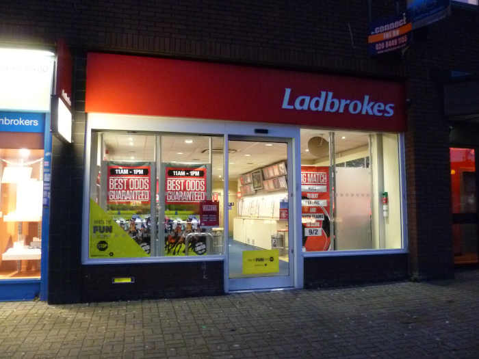 Ladbrokes betting shop at night.