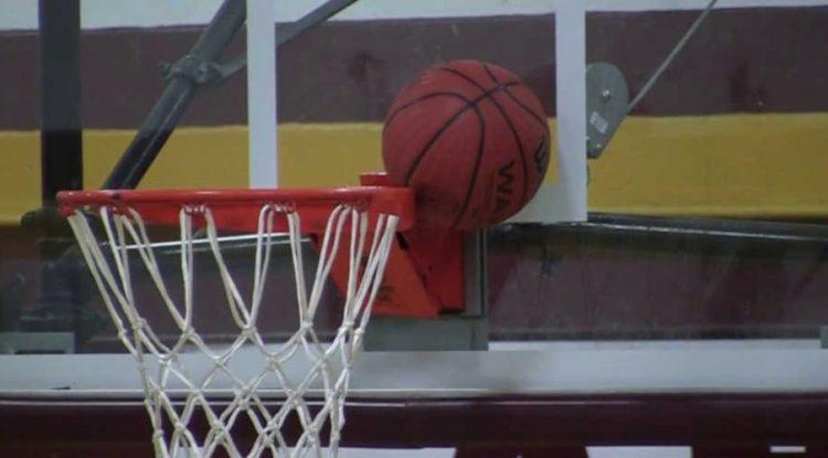 Basketball stuck on a hoop.