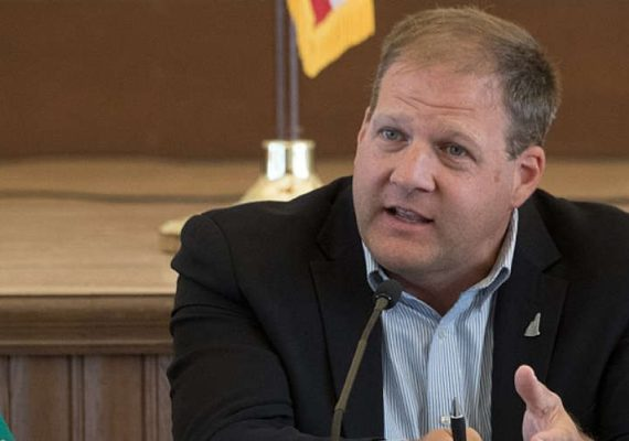 New Hampshire Governor Chris Sununu at a meeting.