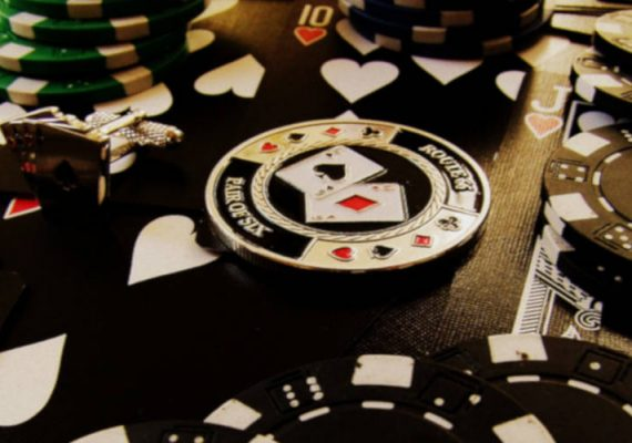Poker chips, cards and table.