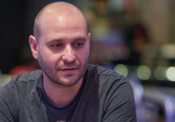 Roberto Romanello at a table of poker during a game.