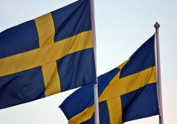 Swedish flags flying.