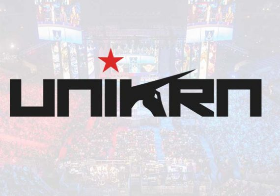 Unikrn's logo against a background of an eSports arena.
